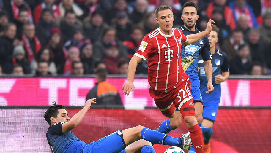 MUNICH, GERMANY - JANUARY 27: Benjamin Huebner of Hoffenheim (l) tries to stop Joshua Kimmich of Bayern Muenchen during the Bundesliga match between FC Bayern Muenchen and TSG 1899 Hoffenheim at Allianz Arena on January 27, 2018 in Munich, Germany. (Photo by Sebastian Widmann/Bongarts/Getty Images)