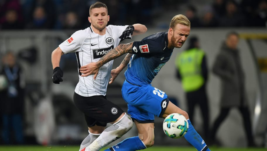 SINSHEIM, GERMANY - NOVEMBER 18: Antje Rebic of Frankfurt and Kevin Vogt of Hoffenheim compete for the ball during the Bundesliga match between TSG 1899 Hoffenheim and Eintracht Frankfurt at Wirsol Rhein-Neckar-Arena on November 18, 2017 in Sinsheim, Germany. (Photo by Matthias Hangst/Bongarts/Getty Images)