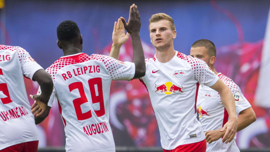 Leipzig's striker Timo Werner (R) celebrates with Leipzig's French forward Jean Kevin Augustin after scoring the first goal for Leipzig during the German first division Bundesliga football match between RB Leipzig and SC Freiburg in Leipzig, eastern Germany on August 27, 2017.  / AFP PHOTO / ROBERT MICHAEL        (Photo credit should read ROBERT MICHAEL/AFP/Getty Images)