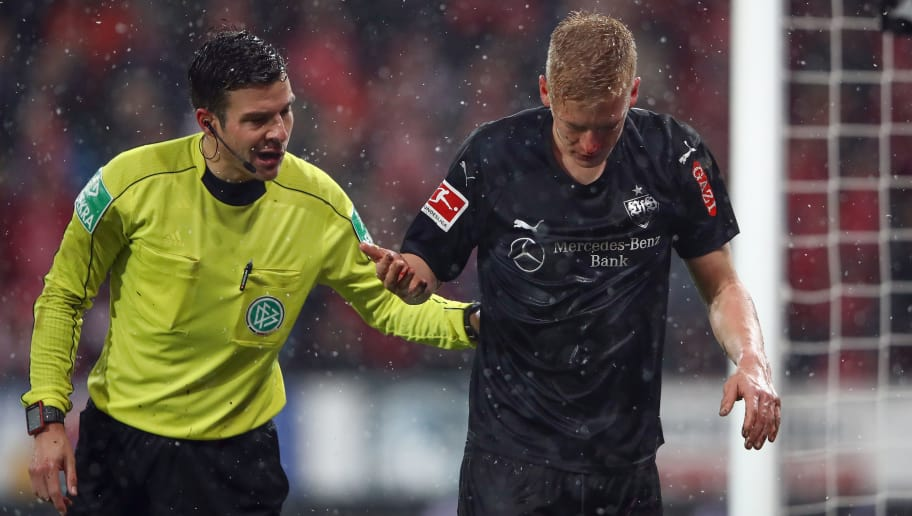MAINZ, GERMANY - JANUARY 20: Referee Harm Osmers looks after Timo Baumgartl of Stuttgart during the Bundesliga match between 1. FSV Mainz 05 and VfB Stuttgart at Opel Arena on January 20, 2018 in Mainz, Germany.  (Photo by Alex Grimm/Bongarts/Getty Images)