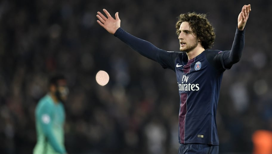 Paris Saint-Germain's French midfielder Adrien Rabiot celebrates after Paris Saint-Germain's players won the UEFA Champions League round of 16 first leg football match between Paris Saint-Germain and FC Barcelona on February 14, 2017 at the Parc des Princes stadium in Paris. / AFP / CHRISTOPHE SIMON        (Photo credit should read CHRISTOPHE SIMON/AFP/Getty Images)
