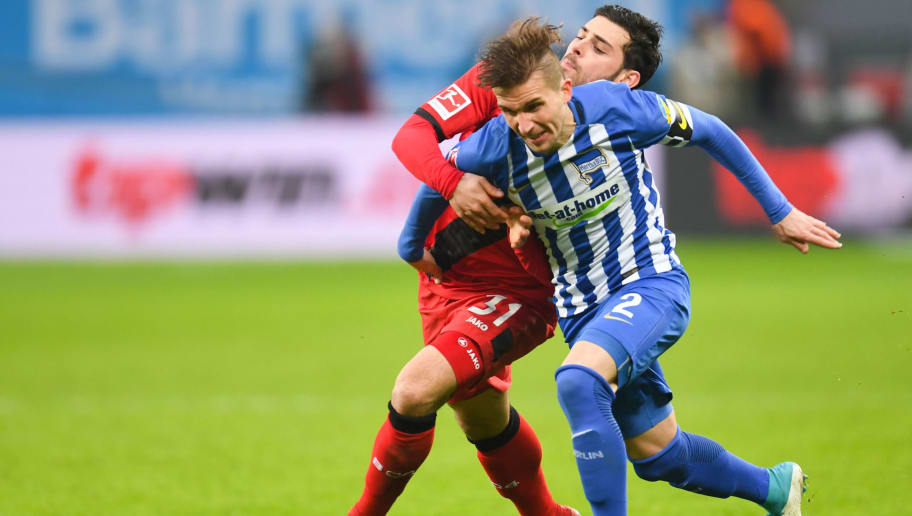 Berlin's Slovakian defender Peter Pekarik (Front) and Leverkusen's German forward Kevin Volland vie for the ball during the German first division Bundesliga football match Bayer 04 Leverkusen vs Hertha BSC Berlin, in Leverkusen, western Germany, on February 10, 2018. / AFP PHOTO / Patrik STOLLARZ / RESTRICTIONS: DURING MATCH TIME: DFL RULES TO LIMIT THE ONLINE USAGE TO 15 PICTURES PER MATCH AND FORBID IMAGE SEQUENCES TO SIMULATE VIDEO. == RESTRICTED TO EDITORIAL USE == FOR FURTHER QUERIES PLEASE CONTACT DFL DIRECTLY AT + 49 69 650050         (Photo credit should read PATRIK STOLLARZ/AFP/Getty Images)