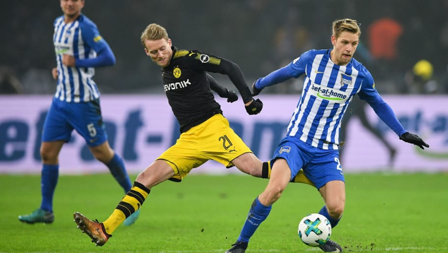 BERLIN, GERMANY - JANUARY 19: Andre Schurrle #21 of Borussia Dortmund and Arne Maier #26 of Hertha Berlin battle for the ball during the Bundesliga match between Hertha BSC and Borussia Dortmund at Olympiastadion on January 19, 2018 in Berlin, Germany. (Photo by Stuart Franklin/Bongarts/Getty Images)