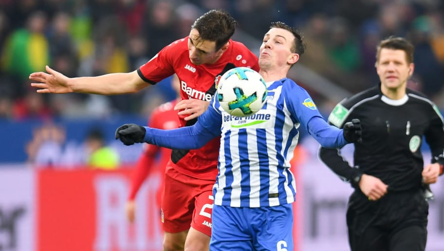 Leverkusen's German midfielder Dominik Kohr and Berlin's Czech midfielder Vladimir Darida vie for the ball  during the German first division Bundesliga football match Bayer Leverkusen versus Hertha Berlin on February 10, 2018 in Leverkusen. / AFP PHOTO / Patrik STOLLARZ / RESTRICTIONS: DURING MATCH TIME: DFL RULES TO LIMIT THE ONLINE USAGE TO 15 PICTURES PER MATCH AND FORBID IMAGE SEQUENCES TO SIMULATE VIDEO. == RESTRICTED TO EDITORIAL USE == FOR FURTHER QUERIES PLEASE CONTACT DFL DIRECTLY AT + 49 69 650050         (Photo credit should read PATRIK STOLLARZ/AFP/Getty Images)