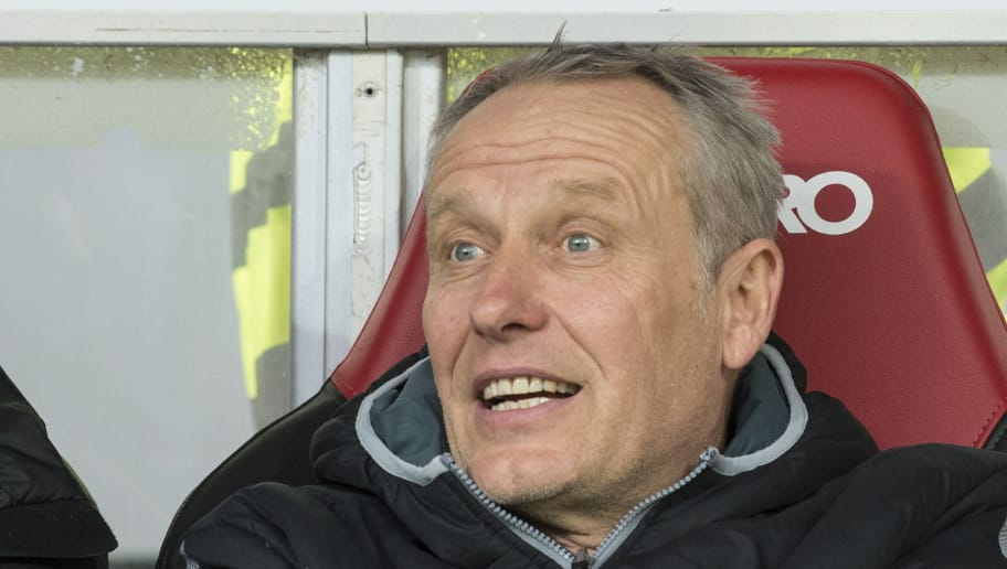 Freiburg's head coach Christian Streich is pictured prior to the German first division Bundesliga football match SC Freiburg vs RB Leipzig in Freiburg, southwestern Germany, on January 20, 2018. / AFP PHOTO / THOMAS KIENZLE / RESTRICTIONS: DURING MATCH TIME: DFL RULES TO LIMIT THE ONLINE USAGE TO 15 PICTURES PER MATCH AND FORBID IMAGE SEQUENCES TO SIMULATE VIDEO. == RESTRICTED TO EDITORIAL USE == FOR FURTHER QUERIES PLEASE CONTACT DFL DIRECTLY AT + 49 69 650050         (Photo credit should read THOMAS KIENZLE/AFP/Getty Images)