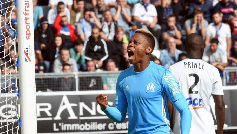 Olympique de Marseille's Cameroonian forward Clinton Njie (C) celebrates after scoring during the French L1 football match between Amiens and Marseille on September 17, 2017 at the Licorne stadium in Amiens. / AFP PHOTO / FRANCOIS LO PRESTI        (Photo credit should read FRANCOIS LO PRESTI/AFP/Getty Images)