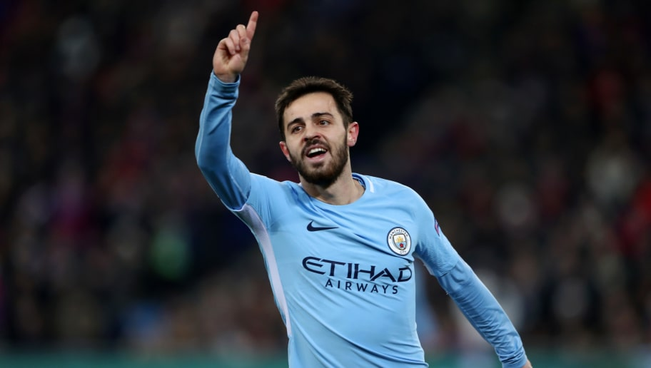 BASEL, SWITZERLAND - FEBRUARY 13: Bernardo Silva of Manchester City celebrates after scoring his sides second goal during the UEFA Champions League Round of 16 First Leg  match between FC Basel and Manchester City at St. Jakob-Park on February 13, 2018 in Basel, Switzerland.  (Photo by Alex Grimm/Bongarts/Getty Images )