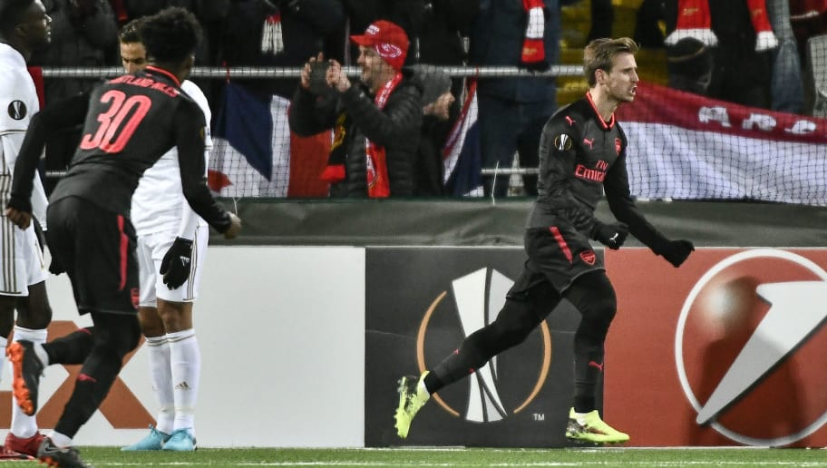 Arsenal's Nacho Monreal (R) celebrates after scoring the 0-1 during the UEFA Europa League round of 32, first leg football match of Ostersund FK vs Arsenal FC on February 15, 2018 in Ostersund, Sweden. / AFP PHOTO / TT NEWS AGENCY / Robert HENRIKSSON / Sweden OUT        (Photo credit should read ROBERT HENRIKSSON/AFP/Getty Images)