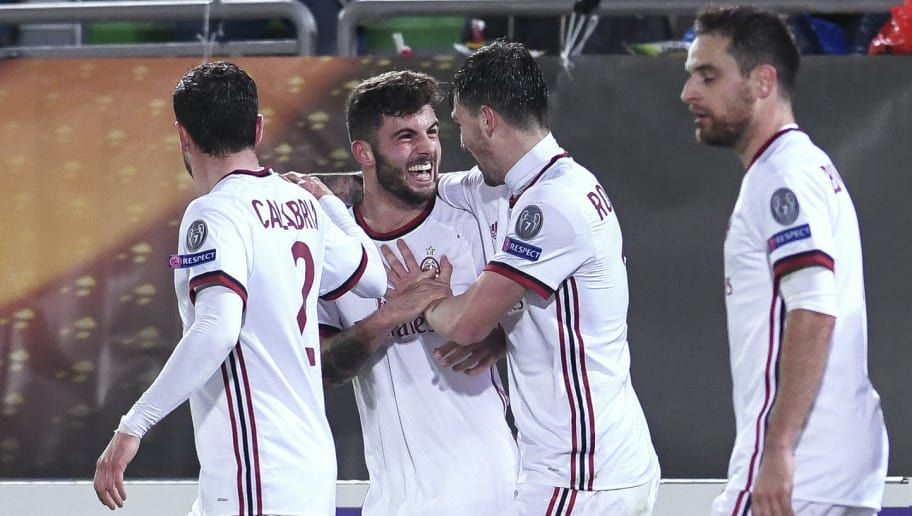 AC Milan's forward Patrick Cutrone (2nd L) celebrates after scoring a goal  during the UEFA Europa League round of 32 first-leg football match between PFC Ludogorets Razgrad and AC Milan in Razgrad on February 15, 2018. / AFP PHOTO / NIKOLAY DOYCHINOV        (Photo credit should read NIKOLAY DOYCHINOV/AFP/Getty Images)