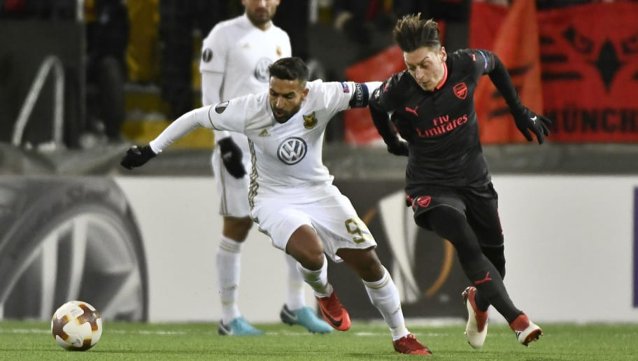 Ostersund's Saman Ghoddos (L) vies for the ball with Arsenal's Mesut Özil during the UEFA Europa League round of 32, first leg football match of Ostersund FK vs Arsenal FC on February 15, 2018 in Ostersund, Sweden. / AFP PHOTO / TT NEWS AGENCY / Robert HENRIKSSON / Sweden OUT        (Photo credit should read ROBERT HENRIKSSON/AFP/Getty Images)