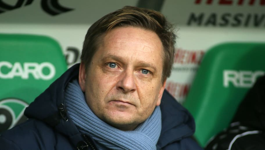 HANOVER, GERMANY - FEBRUARY 10: sports director Horst Heldt of Hannover 96 looks on prior to the Bundesliga match between Hannover 96 and Sport-Club Freiburg at HDI-Arena on February 10, 2018 in Hanover, Germany. (Photo by Selim Sudheimer/Bongarts/Getty Images)