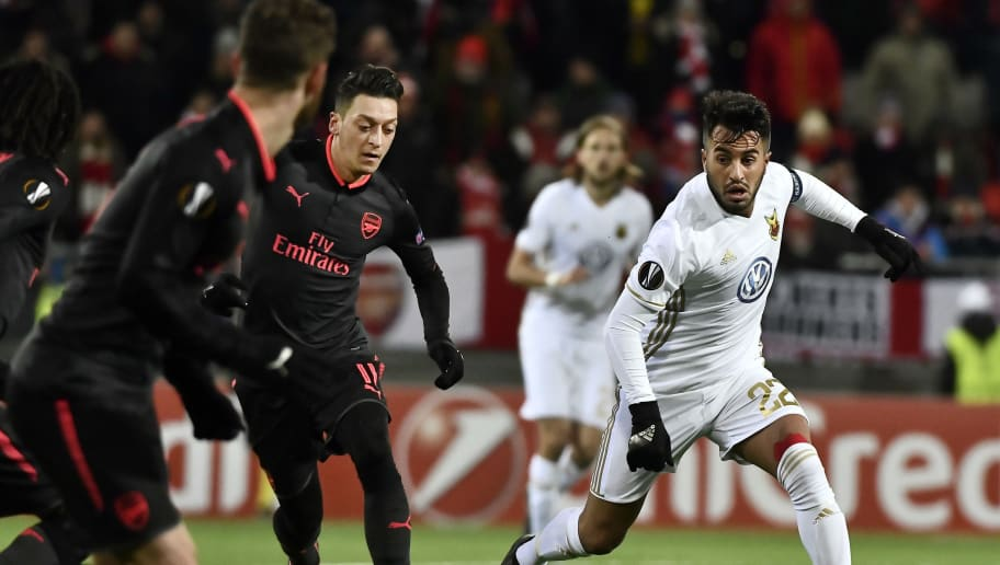 Ostersund's Brwa Nouri (R) and Arsenal's Mesut Özil (2nd L) vie for the ball during the UEFA Europa League round of 32, first leg football match of Ostersund FK vs Arsenal FC on February 15, 2018 in Ostersund, Sweden. / AFP PHOTO / TT NEWS AGENCY / Robert HENRIKSSON / Sweden OUT        (Photo credit should read ROBERT HENRIKSSON/AFP/Getty Images)