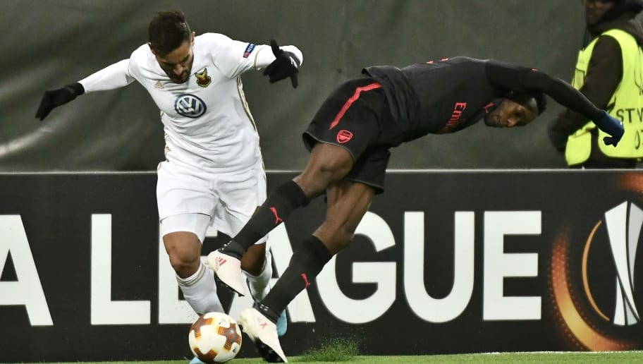 Ostersund's Sotirios Papagiannopoulos (L) vies for the ball with Arsenal's Danny Welbeck during the UEFA Europa League round of 32, first leg football match of Ostersund FK vs Arsenal FC on February 15, 2018 in Ostersund, Sweden. / AFP PHOTO / TT NEWS AGENCY / Robert HENRIKSSON / Sweden OUT        (Photo credit should read ROBERT HENRIKSSON/AFP/Getty Images)