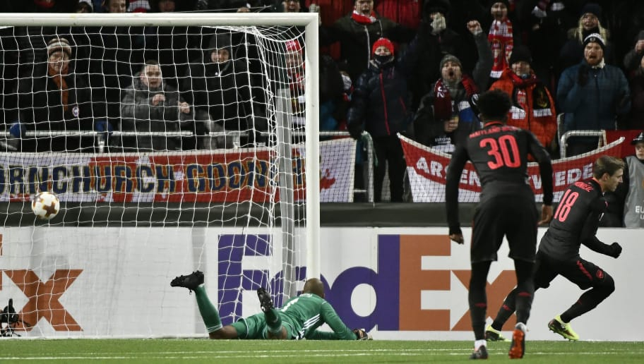 Arsenal's Nacho Monreal (R) celebrates after scoring the 0-1 against Ostersund's goalkeeper Aly Keita (L) during the UEFA Europa League round of 32, first leg football match of Ostersund FK vs Arsenal FC on February 15, 2018 in Ostersund, Sweden. / AFP PHOTO / TT NEWS AGENCY / Robert HENRIKSSON / Sweden OUT        (Photo credit should read ROBERT HENRIKSSON/AFP/Getty Images)