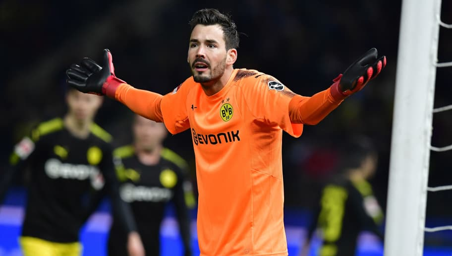 Dortmund's Swiss goalkeeper Roman Buerki reacts during the German first division Bundesliga football match Hertha BSC Berlin vs BVB Borussia Dortmund, in Berlin, western Germany, on January 19, 2018. / AFP PHOTO / Tobias SCHWARZ / RESTRICTIONS: DURING MATCH TIME: DFL RULES TO LIMIT THE ONLINE USAGE TO 15 PICTURES PER MATCH AND FORBID IMAGE SEQUENCES TO SIMULATE VIDEO. == RESTRICTED TO EDITORIAL USE == FOR FURTHER QUERIES PLEASE CONTACT DFL DIRECTLY AT + 49 69 650050         (Photo credit should read TOBIAS SCHWARZ/AFP/Getty Images)
