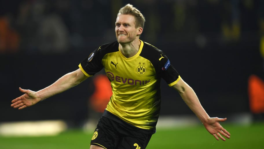 Dortmund's German midfielder Andre Schuerrle celebrates after scoring the 1-0 during the UEFA Europa League round of 32, first leg football match of Germany's Borussia Dortmund vs Italy's Atalanta Bergamo on February 15, 2018 in Dortmund, western Germany. / AFP PHOTO / PATRIK STOLLARZ        (Photo credit should read PATRIK STOLLARZ/AFP/Getty Images)