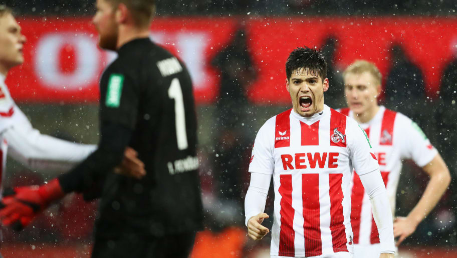 COLOGNE, GERMANY - DECEMBER 16:  Jorge Mere, Timo Horn and Tim Handwerker of FC Koeln celebrate after victory in the Bundesliga match between 1. FC Koeln and VfL Wolfsburg at RheinEnergieStadion on December 16, 2017 in Cologne, Germany.  (Photo by Dean Mouhtaropoulos/Bongarts/Getty Images)