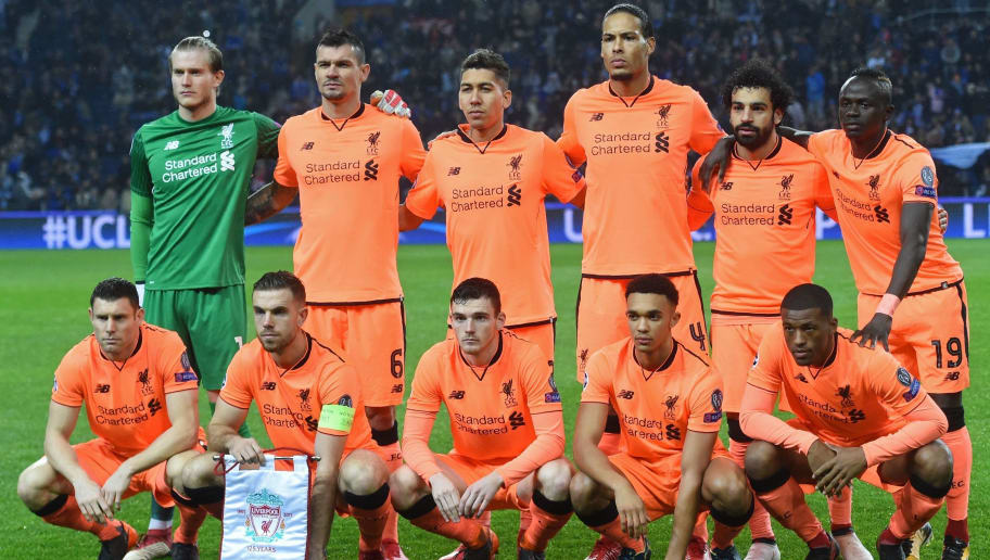 Liverpool players (back row L-R) Liverpool's German goalkeeper Loris Karius, Liverpool's Croatian defender Dejan Lovren, Liverpool's Brazilian midfielder Roberto Firmino, Liverpool's Dutch defender Virgil van Dijk, Liverpool's Egyptian midfielder Mohamed Salah and Liverpool's Senegalese midfielder Sadio Mane (fornt row L-R) Liverpool's English midfielder James Milner, Liverpool's English midfielder Jordan Henderson, Liverpool's Scottish defender Andrew Robertson, Liverpool's English midfielder Trent Alexander-Arnold and Liverpool's Dutch midfielder Georginio Wijnaldum  pose for a photograph aehad of the UEFA Champions League round of sixteen first leg football match between FC Porto and Liverpool at the Dragao stadium in Porto, Portugal on February 14, 2018. / AFP PHOTO / Francisco LEONG        (Photo credit should read FRANCISCO LEONG/AFP/Getty Images)