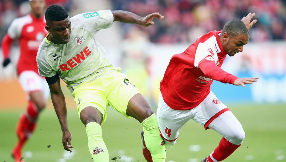 MAINZ, GERMANY - NOVEMBER 18: Jhon Cordoba (L) of Koeln is challenged by Abdou Diallo of Mainz during the Bundesliga match between 1. FSV Mainz 05 and 1. FC Koeln at Opel Arena on November 18, 2017 in Mainz, Germany.  (Photo by Alex Grimm/Bongarts/Getty Images)
