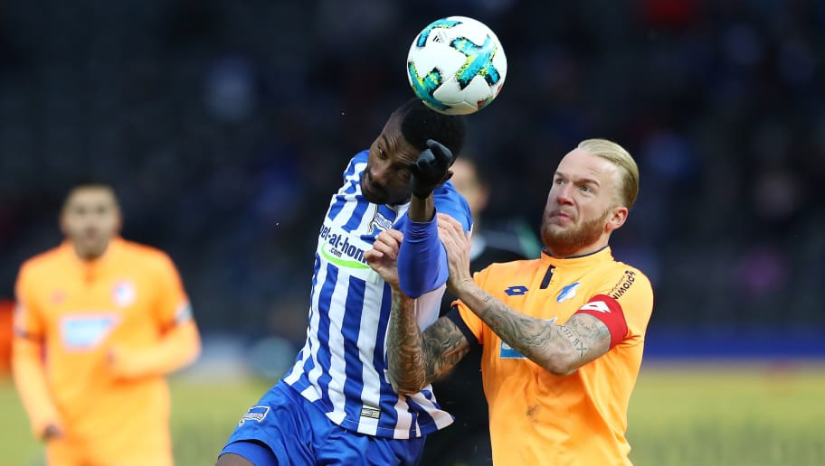 BERLIN, GERMANY - FEBRUARY 03: Salomon Kalou of Berlin (l) fights for the ball with Kevin Vogt of Hoffenheim during the Bundesliga match between Hertha BSC and TSG 1899 Hoffenheim at Olympiastadion on February 3, 2018 in Berlin, Germany. (Photo by Martin Rose/Bongarts/Getty Images)