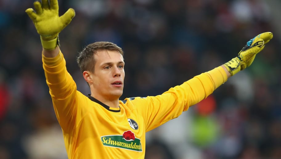 AUGSBURG, GERMANY - DECEMBER 16:  Keeper Alexander Schwolow  of Freiburg reacts during the Bundesliga match between FC Augsburg and Sport-Club Freiburg at WWK-Arena on December 16, 2017 in Augsburg, Germany.  (Photo by Alexander Hassenstein/Bongarts/Getty Images)