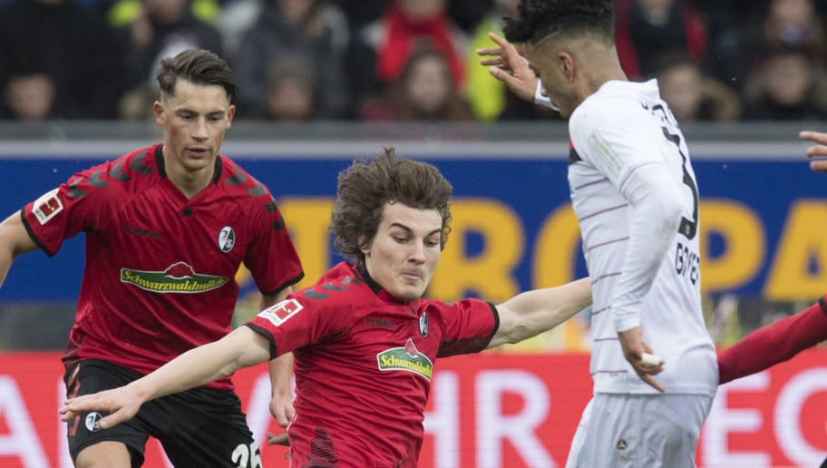 (L-R) Freiburg's defender Robin Koch, Turkish defender Caglar Soeyuencue, Leverkusen's defender Benjamin Henrichs and Freiburg's forward Tim Kleindienst vie for the ball during the German first division Bundesliga football match SC Freiburg versus Bayer Leverkusen on February 3, 2018 in Freiburg. / AFP PHOTO / THOMAS KIENZLE / RESTRICTIONS: DURING MATCH TIME: DFL RULES TO LIMIT THE ONLINE USAGE TO 15 PICTURES PER MATCH AND FORBID IMAGE SEQUENCES TO SIMULATE VIDEO. == RESTRICTED TO EDITORIAL USE == FOR FURTHER QUERIES PLEASE CONTACT DFL DIRECTLY AT + 49 69 650050         (Photo credit should read THOMAS KIENZLE/AFP/Getty Images)