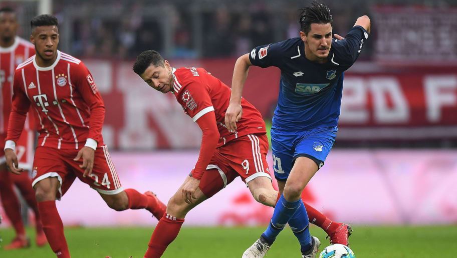 MUNICH, GERMANY - JANUARY 27: Robert Lewandowski of Bayern Muenchen (l) fights for the ball with Benjamin Huebner of Hoffenheim during the Bundesliga match between FC Bayern Muenchen and TSG 1899 Hoffenheim at Allianz Arena on January 27, 2018 in Munich, Germany. (Photo by Matthias Hangst/Bongarts/Getty Images)