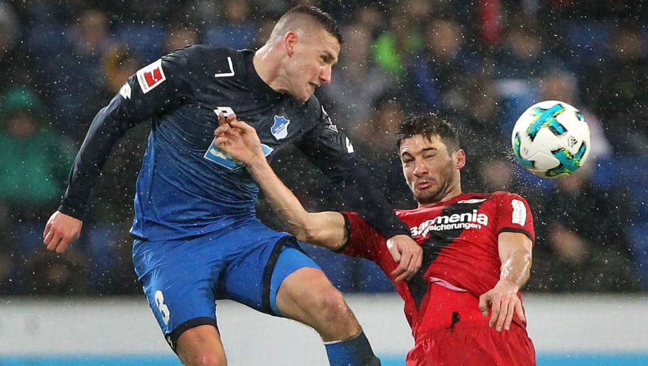 Hoffenheim's Czech defender Pavel Kaderabek (L) and Leverkusen's Argentinean forward Lucas Alario vie for the ball during the German First division Bundesliga football match TSG 1899 Hoffenheim vs Bayer 04 Leverkusen in Sinsheim, southwestern Germany, on January 20, 2018. / AFP PHOTO / Amelie QUERFURTH / RESTRICTIONS: DURING MATCH TIME: DFL RULES TO LIMIT THE ONLINE USAGE TO 15 PICTURES PER MATCH AND FORBID IMAGE SEQUENCES TO SIMULATE VIDEO. == RESTRICTED TO EDITORIAL USE == FOR FURTHER QUERIES PLEASE CONTACT DFL DIRECTLY AT + 49 69 650050         (Photo credit should read AMELIE QUERFURTH/AFP/Getty Images)