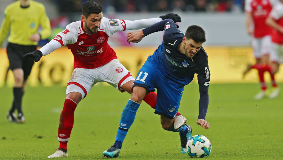 SINSHEIM, GERMANY - FEBRUARY 10:  Florian Grillitsch (R) of Hoffenheim fights for the ball with Danny Latza (L) of Mainz during the Bundesliga match between TSG 1899 Hoffenheim and 1. FSV Mainz 05 at Wirsol Rhein-Neckar-Arena on February 10, 2018 in Sinsheim, Germany.  (Photo by Thomas Niedermueller/Bongarts/Getty Images)