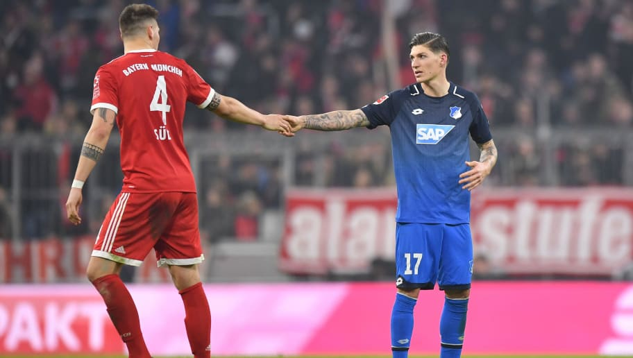 MUNICH, GERMANY - JANUARY 27: Niklas Suele (l) of Muenchen and Steven Zuber of Hoffenheim shake hands after the Bundesliga match between FC Bayern Muenchen and TSG 1899 Hoffenheim at Allianz Arena on January 27, 2018 in Munich, Germany. (Photo by Sebastian Widmann/Bongarts/Getty Images)
