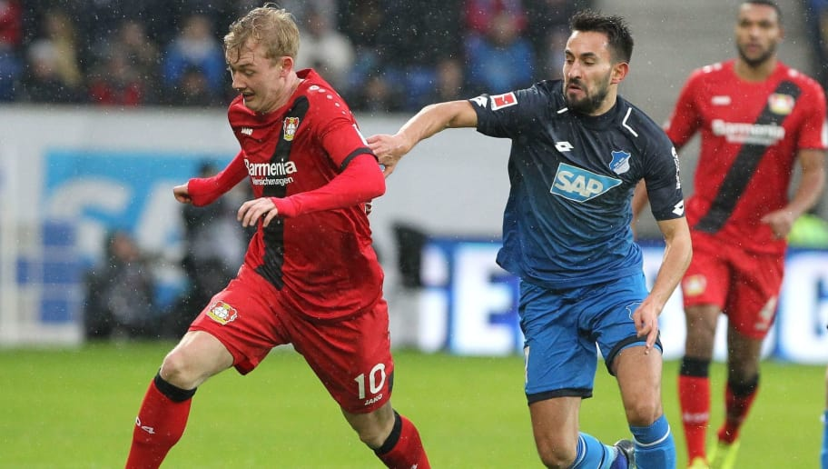 Hoffenheim's German midfielder Lukas Rupp (R) and Leverkusen's German midfielder Julian Brandt (L) vie for the ball during the German First division Bundesliga football match TSG 1899 Hoffenheim vs Bayer 04 Leverkusen in Sinsheim, southwestern Germany, on January 20, 2018. / AFP PHOTO / Amelie QUERFURTH / RESTRICTIONS: DURING MATCH TIME: DFL RULES TO LIMIT THE ONLINE USAGE TO 15 PICTURES PER MATCH AND FORBID IMAGE SEQUENCES TO SIMULATE VIDEO. == RESTRICTED TO EDITORIAL USE == FOR FURTHER QUERIES PLEASE CONTACT DFL DIRECTLY AT + 49 69 650050         (Photo credit should read AMELIE QUERFURTH/AFP/Getty Images)