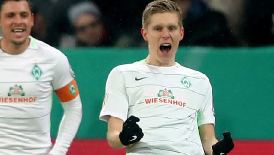 LEVERKUSEN, GERMANY - FEBRUARY 06: Aron Johansson of Bremen (R) celebrates the second goal during the DFB Cup quarter final match between Bayer Leverkusen and Werder Bermen at BayArena on February 6, 2018 in Leverkusen, Germany. (Photo by Christof Koepsel/Bongarts/Getty Images)