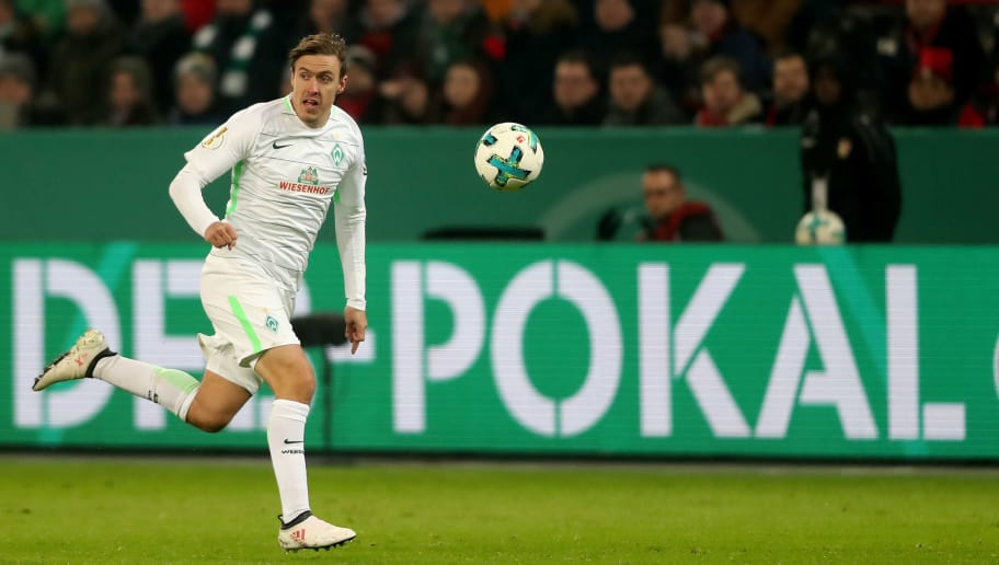 LEVERKUSEN, GERMANY - FEBRUARY 06: Max Kruse of Bremen runs with the ball the DFB Cup quarter final match between Bayer Leverkusen and Werder Bermen at BayArena on February 6, 2018 in Leverkusen, Germany. The match between Leverkusen and Bremen ended 4-2 after extra time. (Photo by Christof Koepsel/Bongarts/Getty Images)