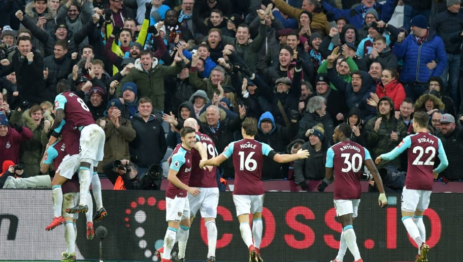 West Ham United's Austrian midfielder Marko Arnautovic (L) celebrates with teammates after scoring their second goal during the English Premier League football match between West Ham United and Watford at The London Stadium, in east London on February 10, 2018. / AFP PHOTO / OLLY GREENWOOD / RESTRICTED TO EDITORIAL USE. No use with unauthorized audio, video, data, fixture lists, club/league logos or 'live' services. Online in-match use limited to 75 images, no video emulation. No use in betting, games or single club/league/player publications.  /         (Photo credit should read OLLY GREENWOOD/AFP/Getty Images)