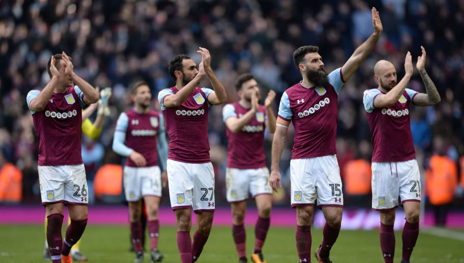 BIRMINGHAM, ENGLAND - FEBRUARY 11: Aston Villa players clap the fans after the Sky Bet Championship match between Aston Villa and Birmingham City at Villa Park on February 11, 2018 in Birmingham, England. (Photo by Nathan Stirk/Getty Images)