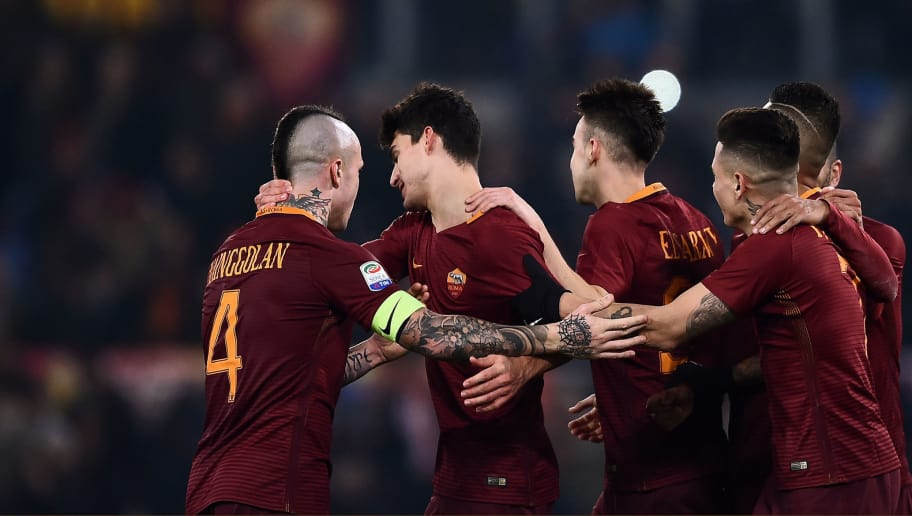 Roma's Argentinan midfielder Diego Perotti (2nd L) celebrates with teammates after scoring a penalty kick during the italian Serie A football match between Roma and Chievo Verona  on December 22, 2016 at the Olympic Stadium in Rome. / AFP / FILIPPO MONTEFORTE        (Photo credit should read FILIPPO MONTEFORTE/AFP/Getty Images)