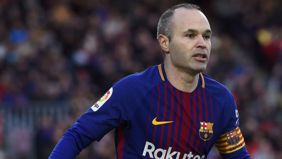 Barcelona's Spanish midfielder Andres Iniesta looks on during the Spanish league football match between FC Barcelona and Getafe CF at the Camp Nou stadium in Barcelona on February 11, 2018. / AFP PHOTO / Josep LAGO        (Photo credit should read JOSEP LAGO/AFP/Getty Images)