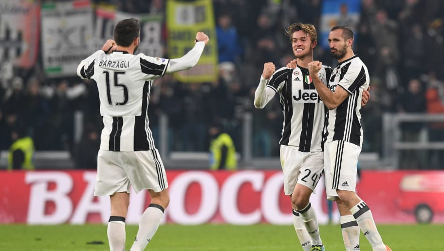 TURIN, ITALY - DECEMBER 17:  Andrea Barzagli, Daniele Rugani (C) and Giorgio Chiellini (R) of Juventus FC celebrate victory at the end of the Serie A match between Juventus FC and AS Roma at Juventus Stadium on December 17, 2016 in Turin, Italy.  (Photo by Valerio Pennicino/Getty Images)