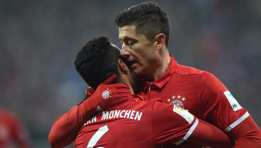Bayern Munich's Spanish midfielder Thiago Alcantara (L) embraces Bayern Munich's Polish striker Robert Lewandowski (R) after a goal  during the German first division Bundesliga football match FC Bayern Munich vs RB Leipzig in Munich, Germany, on December 21, 2016. / AFP / Christof STACHE / RESTRICTIONS: DURING MATCH TIME: DFL RULES TO LIMIT THE ONLINE USAGE TO 15 PICTURES PER MATCH AND FORBID IMAGE SEQUENCES TO SIMULATE VIDEO. == RESTRICTED TO EDITORIAL USE == FOR FURTHER QUERIES PLEASE CONTACT DFL DIRECTLY AT + 49 69 650050         (Photo credit should read CHRISTOF STACHE/AFP/Getty Images)