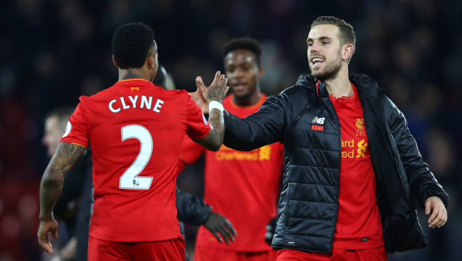 LIVERPOOL, ENGLAND - DECEMBER 31:  Nathaniel Clyne of Liverpool and Jordan Henderson of Liverpool celebrate victory during the Premier League match between Liverpool and Manchester City at Anfield on December 31, 2016 in Liverpool, England.  (Photo by Clive Brunskill/Getty Images)