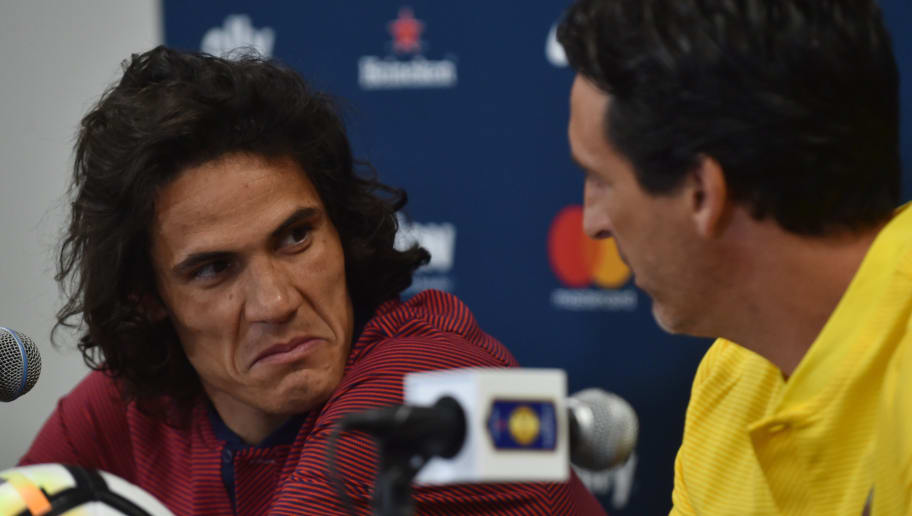 Paris Saint Germain coach Unai Emery (R) and player Edison Cavani (L) give a press conference at Hard Rock Stadium in Miami, Florida, on July 25, 2016, one day before their  their International Champions Cup friendly match against Juventus.  / AFP PHOTO / HECTOR RETAMAL        (Photo credit should read HECTOR RETAMAL/AFP/Getty Images)