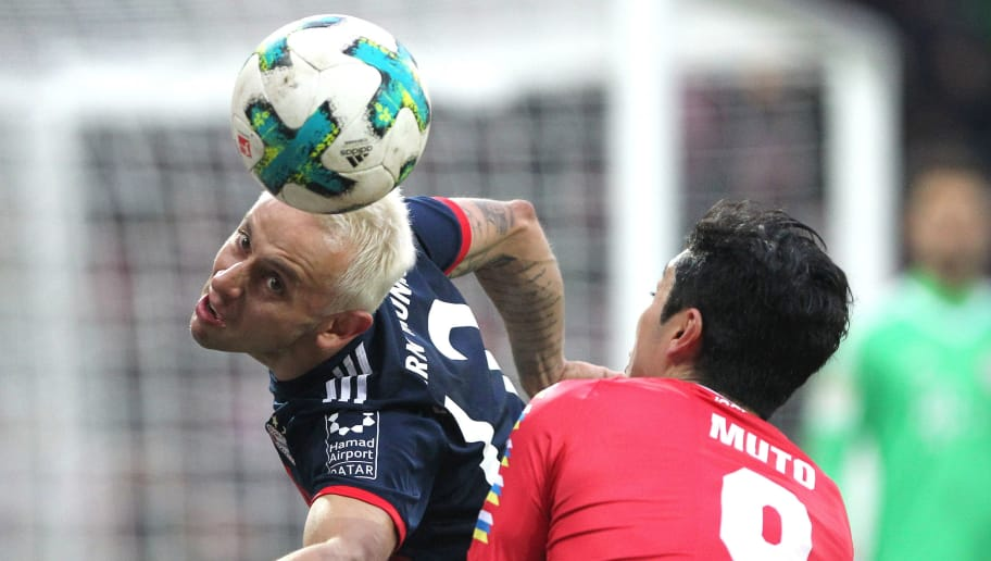 Bayern Munich's Brazilian defender Rafinha (L) heads the ball next to Mainz' Japanese forward Yoshinori Muto  during the German first division Bundesliga football match Mainz 05 versus Bayern Munich on February 3, 2018 in Mainz. / AFP PHOTO / Daniel ROLAND / RESTRICTIONS: DURING MATCH TIME: DFL RULES TO LIMIT THE ONLINE USAGE TO 15 PICTURES PER MATCH AND FORBID IMAGE SEQUENCES TO SIMULATE VIDEO. == RESTRICTED TO EDITORIAL USE == FOR FURTHER QUERIES PLEASE CONTACT DFL DIRECTLY AT + 49 69 650050         (Photo credit should read DANIEL ROLAND/AFP/Getty Images)