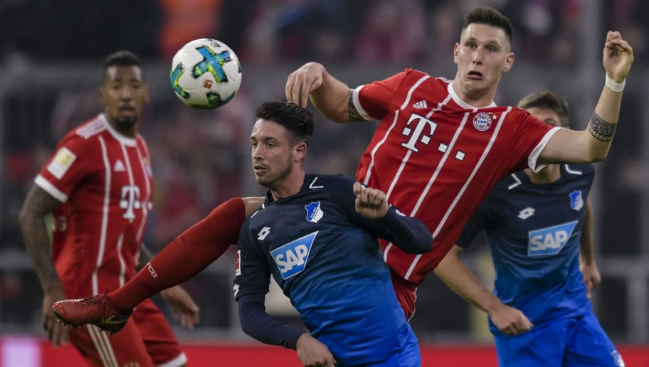 Bayern Munich's German defender Niklas Suele (R) and Hoffenheim's German forward Mark Uth (L) vie for the ball during the German first division Bundesliga football match, Bayern Munich v TSG 1899 Hoffenheim, on January 27, 2018 in Munich, southern Germany. / AFP PHOTO / Gunter SCHIFFMANN / RESTRICTIONS: DURING MATCH TIME: DFL RULES TO LIMIT THE ONLINE USAGE TO 15 PICTURES PER MATCH AND FORBID IMAGE SEQUENCES TO SIMULATE VIDEO. == RESTRICTED TO EDITORIAL USE == FOR FURTHER QUERIES PLEASE CONTACT DFL DIRECTLY AT + 49 69 650050         (Photo credit should read GUNTER SCHIFFMANN/AFP/Getty Images)