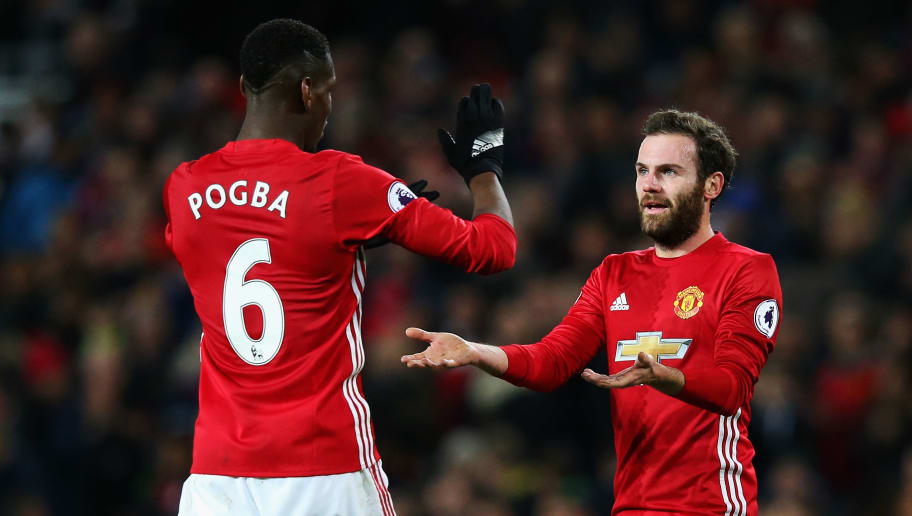 MANCHESTER, ENGLAND - DECEMBER 31:  Paul Pogba of Manchester United celebrates with team mate Juan Mata after victory in the Premier League match between Manchester United and Middlesbrough at Old Trafford on December 31, 2016 in Manchester, England.  (Photo by Alex Livesey/Getty Images)