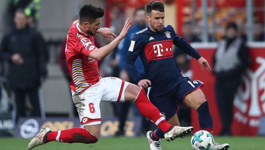 MAINZ, GERMANY - FEBRUARY 03: Juan Bernat of Bayern Muenchen (r) fights for the ball with Danny Latza of Mainz during the Bundesliga match between 1. FSV Mainz 05 and FC Bayern Muenchen at Opel Arena on February 3, 2018 in Mainz, Germany. (Photo by Alex Grimm/Bongarts/Getty Images)
