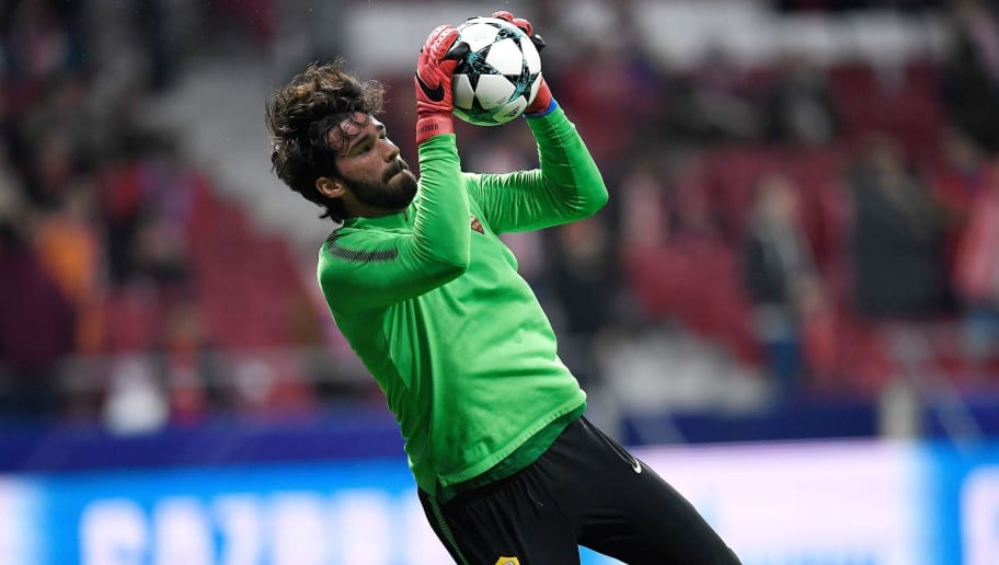 Roma's Brazilian goalkeeper Alisson warms up ahead of the UEFA Champions League group C football match between Atletico Madrid and AS Roma at the Wanda Metropolitan Stadium in Madrid on November 22, 2017. / AFP PHOTO / GABRIEL BOUYS        (Photo credit should read GABRIEL BOUYS/AFP/Getty Images)