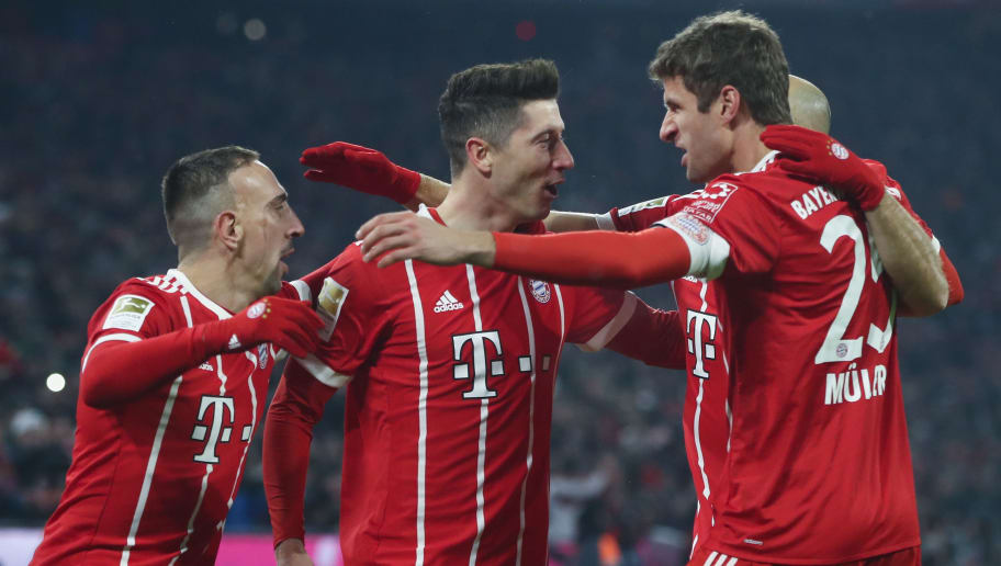 MUNICH, GERMANY - FEBRUARY 10:  Robert Lewandowski of Muenchen celebrates his team's first goal with team mates during the Bundesliga match between FC Bayern Muenchen and FC Schalke 04 at Allianz Arena on February 10, 2018 in Munich, Germany.  (Photo by Alex Grimm/Bongarts/Getty Images)