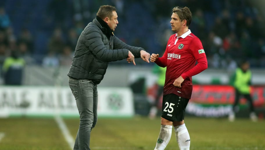 HANOVER, GERMANY - FEBRUARY 10: Headcoach Andre Breitenreiter talks to Oliver Sorg of Hannover 96 during the Bundesliga match between Hannover 96 and Sport-Club Freiburg at HDI-Arena on February 10, 2018 in Hanover, Germany. (Photo by Selim Sudheimer/Bongarts/Getty Images)