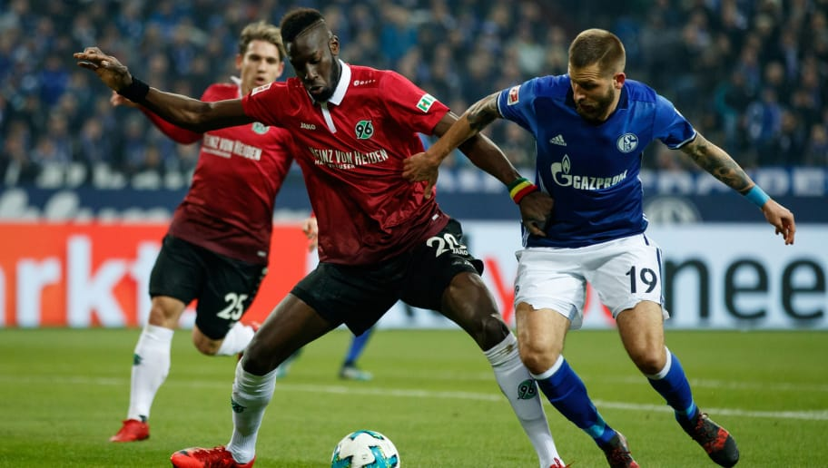 GELSENKIRCHEN, GERMANY - JANUARY 21:  Salif Sane of Hannover challenges Guido Burgstaller of Schalke during the Bundesliga match between FC Schalke 04 and Hannover 96 at Veltins-Arena on January 21, 2018 in Gelsenkirchen, Germany.  (Photo by Lars Baron/Bongarts/Getty Images)