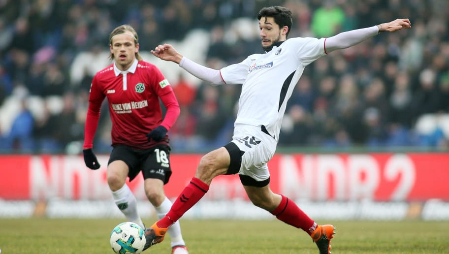 HANOVER, GERMANY - FEBRUARY 10: Iver Fossum of Hannover 96 (L) fights for the ball with Tim Kleindienst of SC Freiburg during the Bundesliga match between Hannover 96 and Sport-Club Freiburg at HDI-Arena on February 10, 2018 in Hanover, Germany. (Photo by Selim Sudheimer/Bongarts/Getty Images)